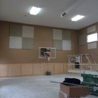 Helping turn a gym into a classroom with Acoustical Surfaces.