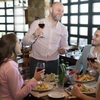 people enjoying restaurant food