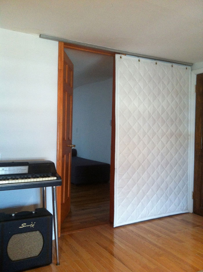 Quilted Curtain Covering Door