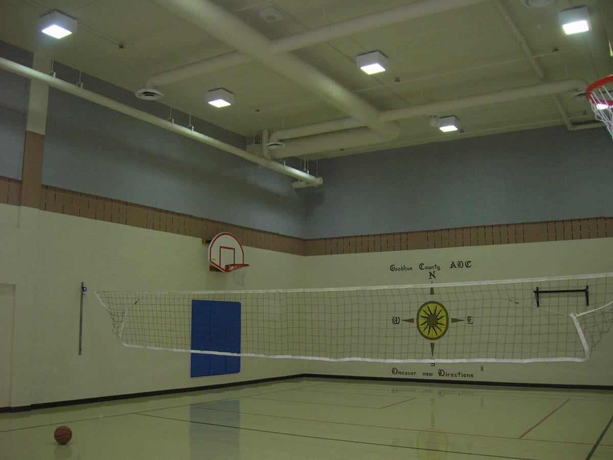 A gym with acoustical baffles and wall solutions installed by Acoustical Surfaces.